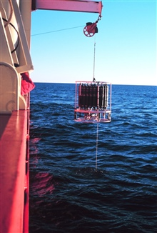 Conductivity-Temperature-Depth (CTD) rosette and water sample bottles beingdeployed from Baltic Room on the NATHANIEL B. PALMER.