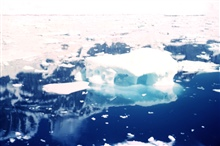 Ice in Peltier Channel - large white ice berg is 50 to 100 feet high.64 52 S Latitude 63 32 W Longitude.