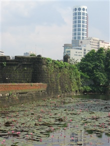 A view of a modern building from the inner fort of the Intramuros of Manila.