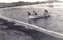 Skiff from PIONEER in the Aleutians with an easy landing.Landing party on Sequam Island.