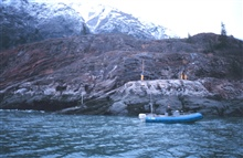 The Tide Gauge Team installing a tide gauge in the icy waters of Tracy Arm