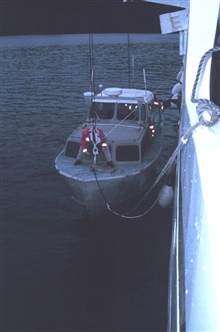 Senior Survey Tech Paul McAnally secures the bow hook on RA-1 prior to hoistingboat out of water.