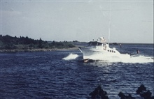 NOAA Launch 1257.Roaring home up the St. Marks River after a day's work in the Gulf.
