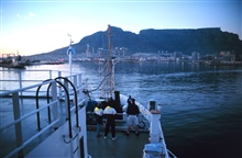 The RONALD H. BROWN pulling into Capetown, South Africa at the end of theAerosols cruise.  The flat mountain is Table Mountain, a famousSouth African landmark.