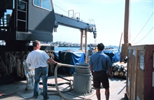 Crewmembers Jonathan Shannahoff and Mike Conway help tieup the RONALD H. BROWN in Male, capital of the Maldive Islands.