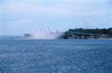 A view of filling a bulk carrier ship with phosphate at the piers at Nauru asseen from the NOAA Ship RONALD H. BROWN.