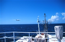 A NASA plane making atmospheric readings makes a low pass off the bow of theRONALD H. BROWN during NAURU99.