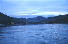 Entering Dutch Harbor at twilight during RONALD H. BROWN around the world cruise in 1999.