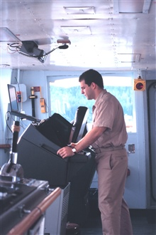 Ensign Dann Karlson checks the ARPA radar for contacts in Stephens Passage