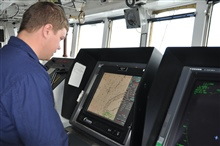 Monitoring NOAA Ship FAIRWEATHER's position on an electronic chart off CapePrince of Wales, the westernmost point of North America.