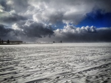 The first large winter storm of 2015 rolls over a frozen Sandusky Baywith 30-45 mph winds.
