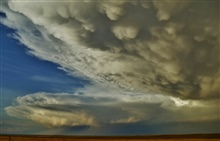 Supercell thunderstorms (including mammatus under a back-sheared anvil).