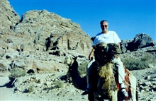Ben Mieremet riding a camel.