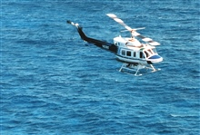 Bell 212 helicopter equipped with SHOALS Lidar sounding system off Cancun,Mexico
