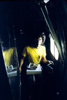 Howie at lunch, even hurricane hunters have to eat.  Flying to Tropical StormDawn in ESSA research aircraft DC-6 40C.