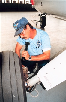 Kevin Rotteveel performing maintenance on Twin Otter