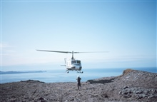 Helping guide Bell helicopter to safe landing along the Alaska Peninsula.