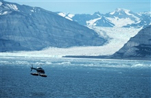 Lieutenant Bill Harrigan flying Bell 206 during Icy Bay current studies.
