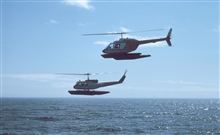Upper helicopter Bell 206 Jet Ranger; lower helicopter Bell UH-1H Huey at CapeDouglas.