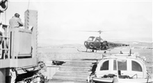 Contract Kern Helicopter flown off the Coast and Geodetic Survey Ship PIONEER,the first instance of a helicopter supporting ship operations for the C&GS.;Makeshift wooden helicopter deck on stern of PIONEER.