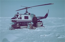 Brendan Kelley, University of Alaska, Fairbanks, conducting seal research on thefrozen Beaufort Sea north of Prudhoe. Clyde, the wonder dog, and Henrywere used to sniff out seal breathing holes.  Note the coats on dogs.  It wascoldddd!!!!