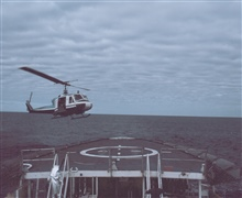 NOAA Bell UH-1M operating off NOAA Ship SURVEYOR helicopter platform.