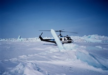 Bell UH-1M on the ice of the Beaufort Sea conducting seal research.