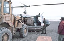 Loading Bell UH-1M helicopter with camp gear for bird studies in the Prudhoe Bay area.