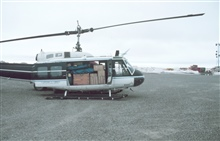 Loaded Bell UH-1M helicopter with camp gear for bird studies in the Prudhoe Bay area.