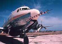 Weather Bureau DC-6 N6539C on tarmac with ESSA designator.  Gust probe inforeground
