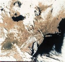 The U. S. northeast and mid-Atlantic coast as observed by a polar orbitingoperational environmental satellite.  Coastline configuration, snow-cover, andcloud cover are all evident in this image.  The surface structure of theAppalachian Mountains is a