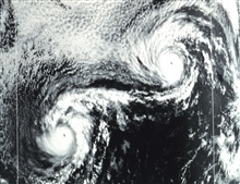 NOAA-3 visible range VHRR image of Hurricanes Ione (left) and Kirsten (right.)The rare effect of two interacting hurricanes is termed the Fujiwhara effect.