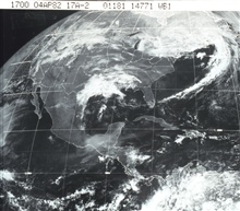 GOES image of North America with storm system over southern states and frontalsystem off the East Coast.