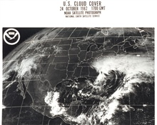 GOES image of North America with storm system over North Carolina and frontalsystem off the East Coast.