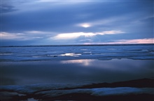 Crepuscular rays illuminate the melting ice of the Beaufort Sea