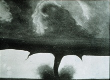 One of the oldest known photographs of a tornado.  It is probable this image has been doctored from the original.  At this time, the oldest known photographof a tornado was taken on April 26, 1884 at Garnett, Kansas.  See:Weatherwise for March-April