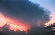 Thunderstorm anvil at sunset.