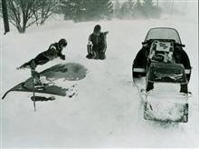 Red Cross workers search for victims buried in cars following snowfallduring the Blizzard of 77.  Only about 12 inches of new snow fell during thisevent but high winds coupled with existing snow in western New York andaccumulated snow on the surface