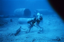 Diver laying transect line for conducting fish survey. This picture taken verysoon after placement of artificial reef materials and very little growthof biota had occurred on pipes.