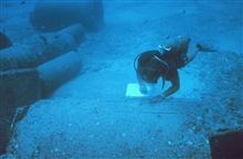Underwater writing slates were used to record the different species adhering to the top, side and interior roof of pipes over time.