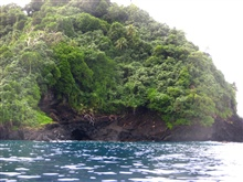 A sea cave or lava tube on the volcanic shores of American Samoa.
