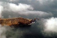 Anacapa Island and lighthouse through the clouds.