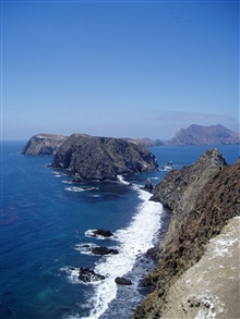Looking west from East Anacapa Island along the sheer cliffs of the south sideof the island.