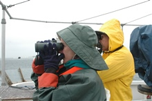 Seabird observers Barbara Blackie and Scott Mills are searching for birds fromthe NOAA Ship McARTHUR II while it was operating in sanctuary waters.