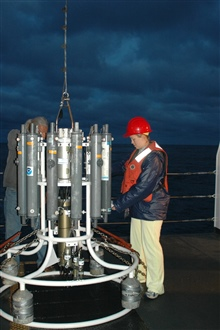 Oceanographer Liz Zele prepares to deploy the CTD from the deckof the NOAA Ship McARTHUR II with the help of technician Lacey O'Neal.