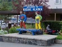 Fishermen with Paul Bunyanesque size salmon greet visitors to Kodiak.