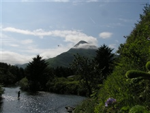 Idyllic view of fisherman in Kodiak stream with Barometer Mountain in thebackground.