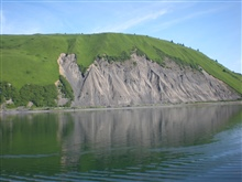 Large landslide scar on Kodiak hillside.