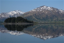 Kodiak mountain reflections on a calm cove.