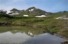 An alpine lake in the mountains of Kodiak.